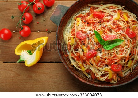 Homemade Spaghetti Bolognese on pan, on wooden background - stock photo