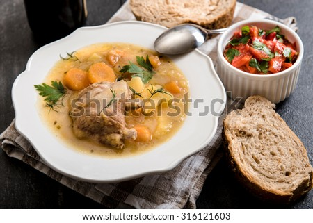 Homemade stew soup with vegetables and beef ribs in the plate,selective focus - stock photo