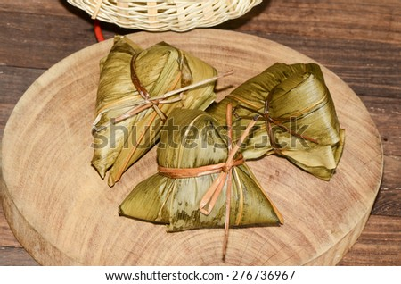 Homemade sticky rice dumpling with generous fillings / Rice dumplings or chang / Chang  are eaten by the Chinese during the Duanwu festival - stock photo