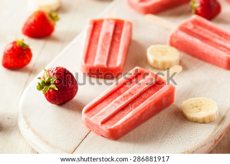 Homemade Strawberry and Banana Popsicles on a Stick - stock photo