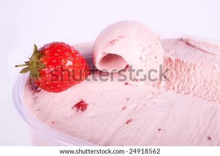 Homemade strawberry ice cream and one nice curl - stock photo