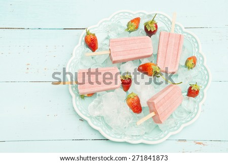 homemade Strawberry Popsicles on ice cube - stock photo