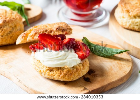 Homemade strawberry shortcake with vanilla whipped cream and berry compote - stock photo