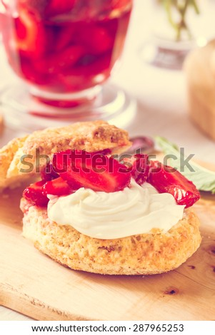 Homemade strawberry shortcake with vanilla whipped cream and berry compote,  pastel toned - stock photo