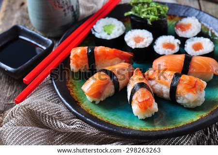 homemade sushi with wild salmon, shrimp, cucumber and seaweed. selective focus - stock photo