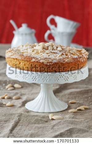 Homemade sweet cake with almonds and cream, selective focus - stock photo