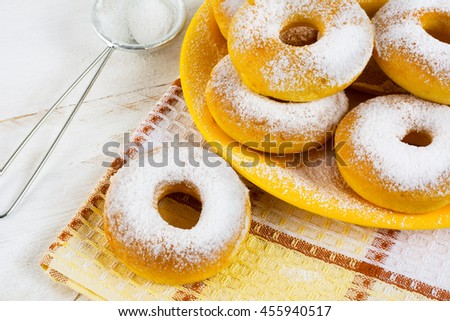 Homemade sweet donuts with caster sugar on checkered napkin. Hanukkah sweet donuts. Sweet dessert pastry doughnuts.   - stock photo