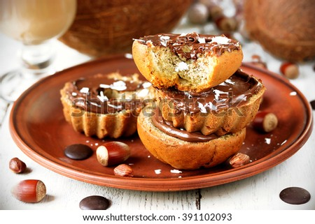 Homemade tasty baking muffins with banana, chocolate paste nutella and hazelnut selective focus - stock photo