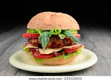 Homemade tasty hamburger with meat, cheese and vegetables - stock photo