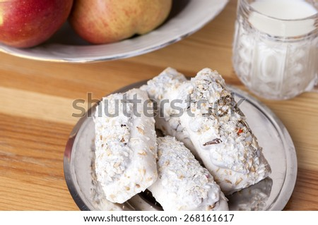 Homemade Tasty Milk Cookies with Cream Dressings and Condensed Milk Filling against of Glass of Milk on Wooden Background. Horizontal Image - stock photo