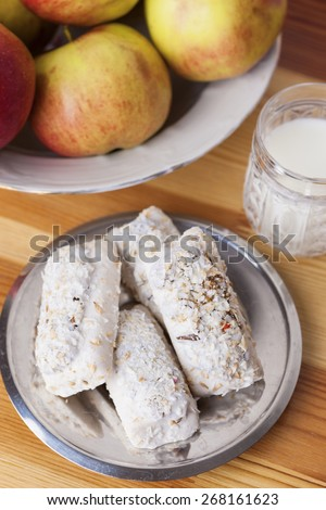 Homemade Tasty Milk Cookies with Cream Dressings and Condensed Milk Filling against of Glass of Milk on Wooden Background. Vertical Image - stock photo
