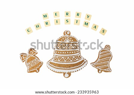 Homemade three bells gingerbread and honey cookies on nice christmas theme with a wishes on white background. - stock photo