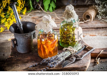 Homemade tincture in bottles as natural medicine - stock photo