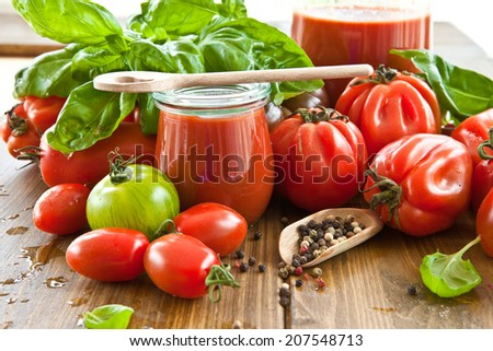 Homemade tomato sauce made from fresh tomatoes and basil - stock photo