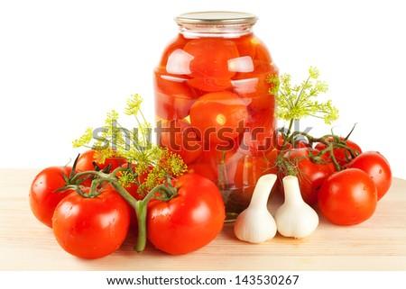 Homemade tomatoes preserves in glass jar. Fresh and canned tomatoes. - stock photo