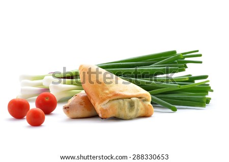 Homemade turnovers with  green onion and tomato  on white background - stock photo
