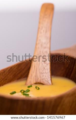 Homemade vegan carrot soup in wooden bowl. - stock photo
