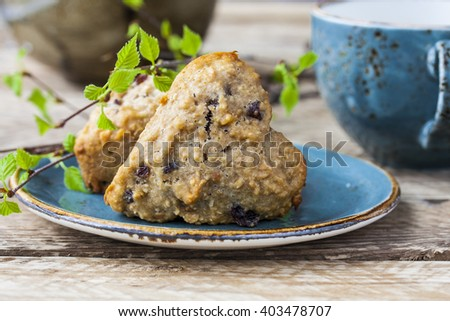 homemade vegan muffins with raisins and cereal in the shape of a heart - stock photo