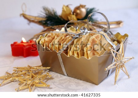 Homemade waffles for Christmas and New Year gift in a golden box, arranged with festive decoration - stock photo