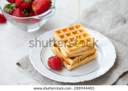 Homemade Waffles with Honey and Strawberries Delicious Food - stock photo