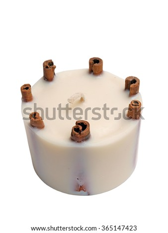 Homemade white candle with six cinnamon rolls inside isolated on white with clipping path.        - stock photo