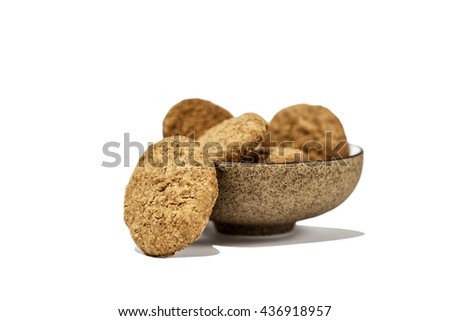 homemade whole meal cereal cookies made from whole wheat flour, vegetable oil, rice flour, corn flour, rye flour and fructo-oligosaccharides in a brown chinaware bowl - stock photo