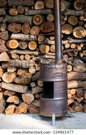 Homemade wood burner made off an old barrel - stock photo