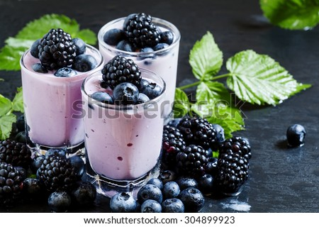 Homemade yogurt and milk cocktail with  blackberries and blueberries,  selective focus - stock photo