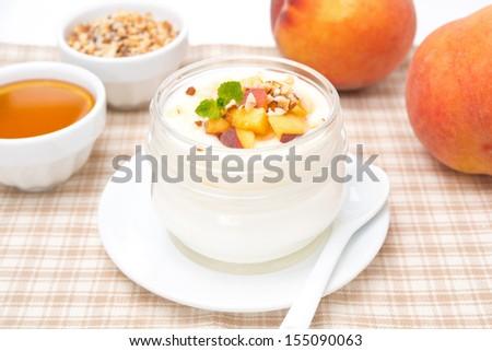 homemade yogurt with honey, fresh peaches and nuts, horizontal - stock photo