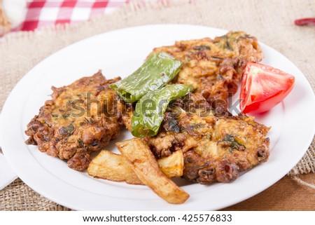 Homemade zucchini fritters with chorizo sausage and corn salsa, mucver  - stock photo