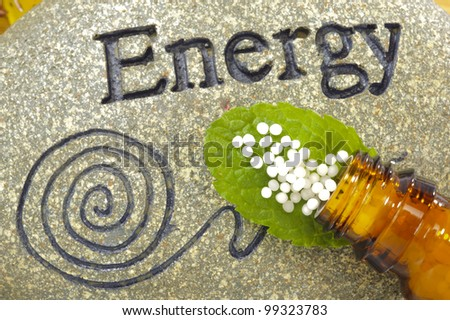 homeopathic globules on stone of energy - stock photo