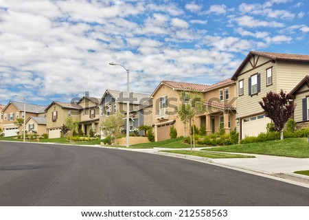 Homes in the suburbs are built on a hill. - stock photo