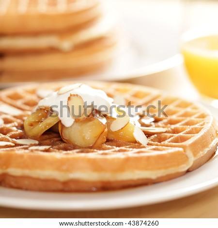Homestyle waffles with orange juice - stock photo