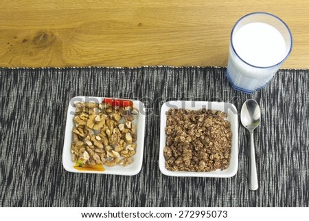 Homework diet breakfast, oatmeal with nuts and milk diet weight loss - stock photo