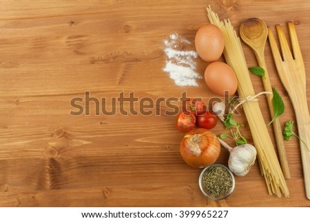 Homework pasta foods. Ingredients for cooking, spread out on the kitchen table. Traditional Italian food. Diet food. - stock photo