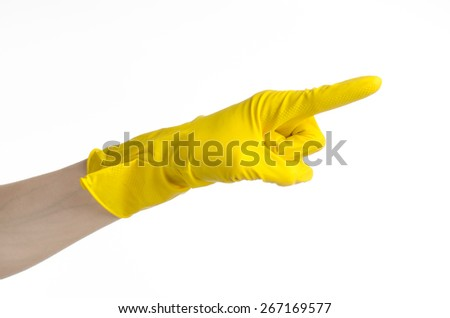 Homework, washing and cleaning of the theme: man's hand holding a yellow and wears rubber gloves for cleaning isolated on white background in studio - stock photo