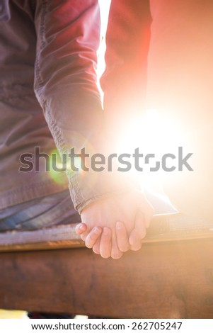 Homosexual couple holding tight hands - stock photo