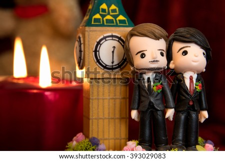 homosexuality, same-sex marriage with two groom figurines and love concept - stock photo