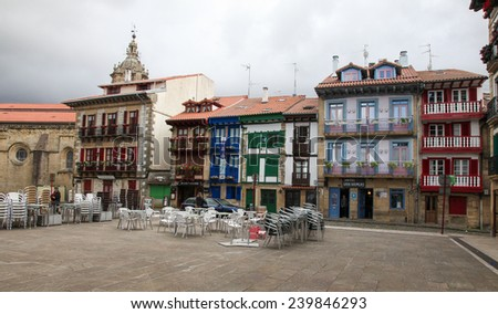 HONDARRIBIA, SPAIN - MAY 26, 2014: Houses at the Plaza Arma in the Port Area in Hondarribia, a town in Gipuzkoa, Basque Country, Spain, near the French border. - stock photo