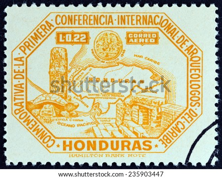 """HONDURAS - CIRCA 1947: A stamp printed in Honduras from the """"1st International Conference of Caribbean Archaeologists """" issue shows map of Honduras and Copan antiquities, circa 1947.  - stock photo"""