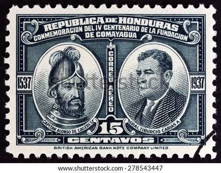 HONDURAS - CIRCA 1937: A stamp printed in Honduras issued for the 400th anniversary of Comayagua shows Alonso de Caceres and Tiburcio Carias Andino, circa 1937.  - stock photo