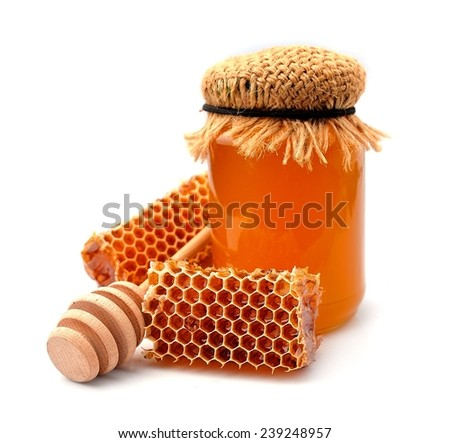 Honey and honeycomb close up on a white background  - stock photo