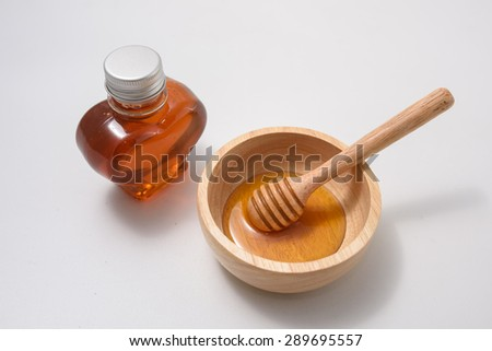 honey bottom shape heart and honey in bowl on white background - stock photo