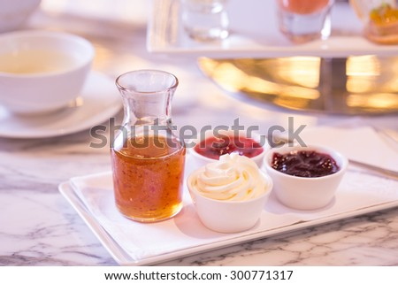 honey, butter and fruity jams isolated on the table - stock photo