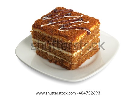 Honey cake in plate on white background - stock photo