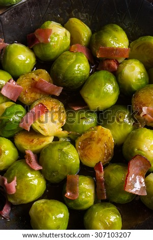 Honey caramelized brussels sprouts with ham - stock photo
