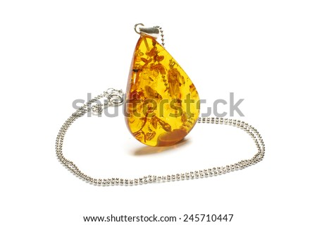 Honey color amber neck adornment isolated - stock photo