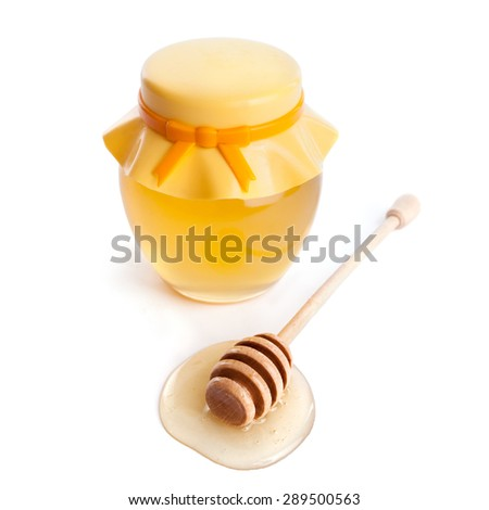 honey dipper and honey in jar on white background - stock photo
