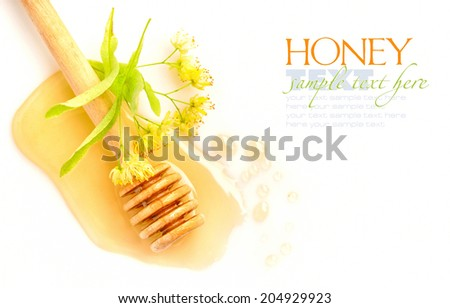 Honey dipper with honey with flowers of linden on white background - stock photo