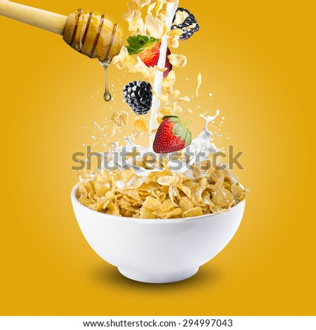 Honey Drip Into Bowl of Cereal With Berries - stock photo